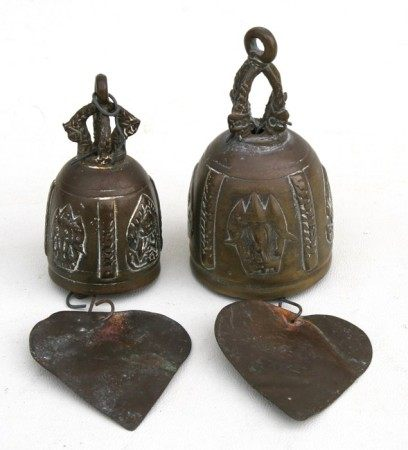 A pair of Tibetan bronze roof bells with Buddhist motifs and attached wind chimes, the largest 10cms