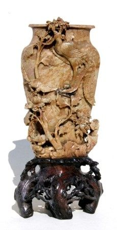 A large Chinese carved soapstone vase on stand decorated with birds and flowers, 38cms (15ins)