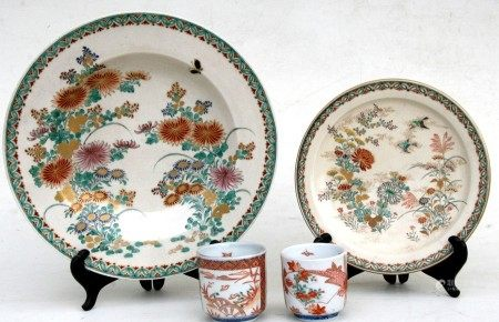 A pair of Japanese yunomi tea cups decorated with flowers; together with a Japanese Satsuma dish and