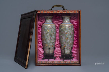 A pair of Chinese famille rose 'millefleurs' eggshell vases, Qianlong mark, Republic, 20th C.