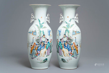 A pair of Chinese famille rose vases with scholars in a garden, 19/20th C.