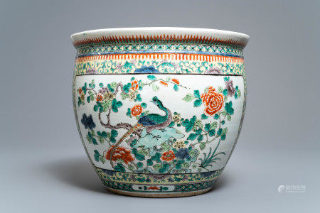 A Chinese famille verte fish bowl with birds among flowers, 19th C.