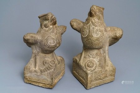 A pair of large carved stone 'phoenix' figures, Yuan or Ming
