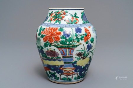 A Chinese wucai vase with vases in a garden, Transitional period