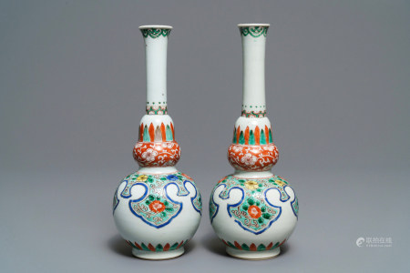 A pair of Chinese famille verte double gourd vases, Kangxi