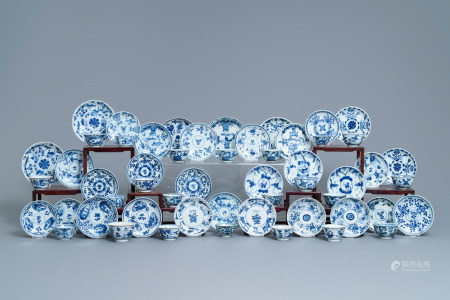 A collection of 22 Chinese blue and white cups and 32 saucers, Kangxi/Qianlong