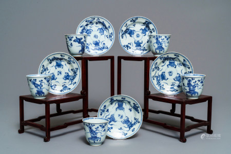 Five Chinese blue and white floral cups and saucers, Kangxi