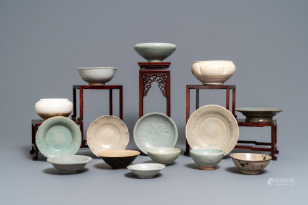 A collection of 15 Chinese celadon- and cream-glazed wares, Song and later