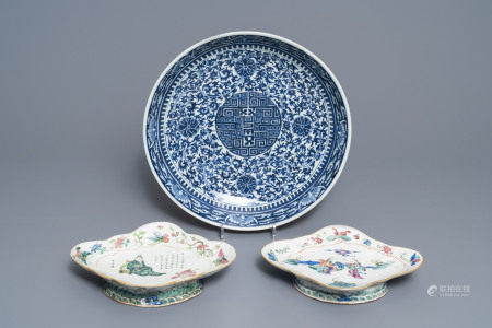 A Chinese blue and white charger and two famille rose bowls, 19th C.