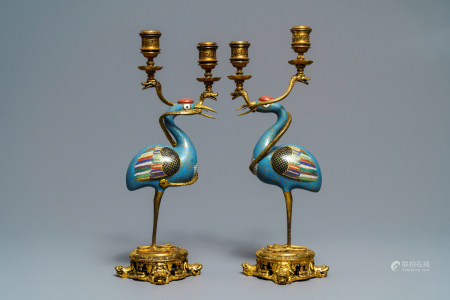 A pair of Chinese cloisonné gilt bronze candelabra mounted cranes, 18/19th C.