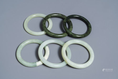 Six Chinese celadon and spinach green jade bangles, 19/20th C.