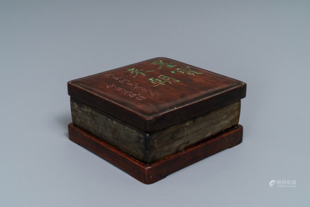 A square Chinese inscribed wood-encased duan inkstone, 19/20th C.