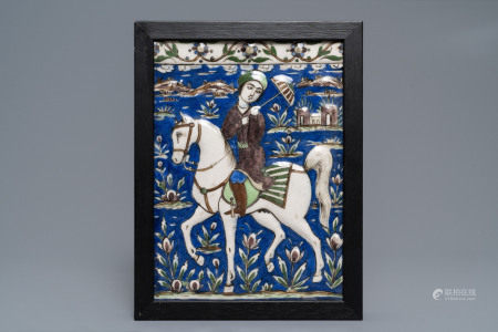 A rectangular Qajar moulded tile with a prince on horseback, Iran, 19th C.