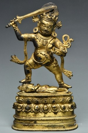 A EARLY MING DYNASTY GILT BRONZE MAHAKALA
