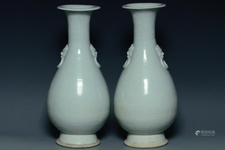 A PAIR OF YUAN DYNASTY QINGBAI VASES