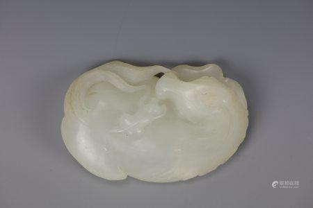 A Chinese White Jade Sleeping Horse