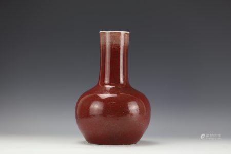 A COPPER-RED-GLAZED BOTTLE VASE Qing Dynasty