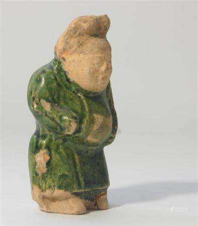 A Rare Pottery Dwarf, the Short Stocky Figure Dressed in a G