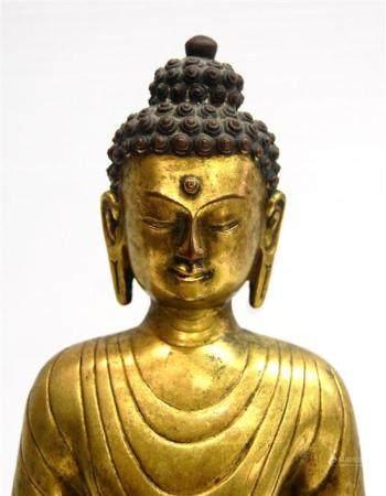 A Fine Sino-Tibetan Gilt Bronze Alloy Buddha, the Tall, Slen