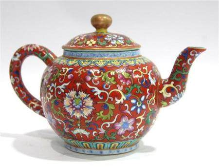 A Spherical Ruby Ground Famille Rose Covered Teapot, Qianlon