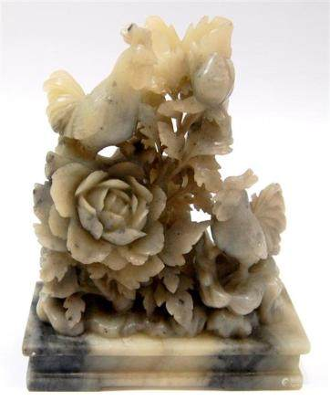 A Chinese Grey & White Jade Carving of Chickens in a Floweri