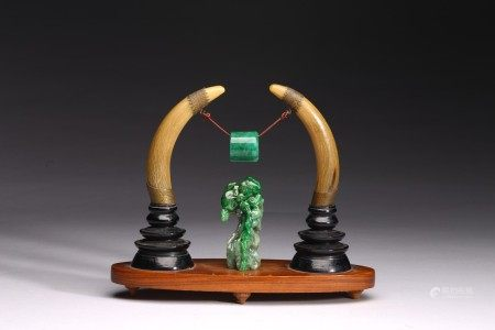 A GROUP OF WALRUS TUSK AND JADEITE CARVINGS