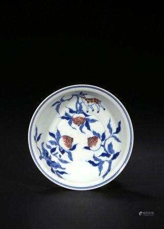 A BLUE AND WHITE RED GLAZED 'PEACH' DISH