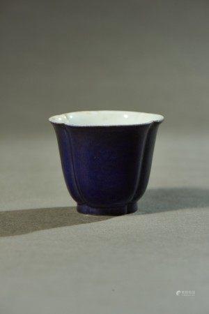 A PURPLE GLAZED LOBED CUP