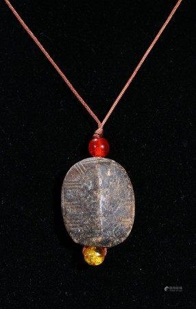 A CLEADON JADE 'TURTLE SHELL' FORM PENDANT