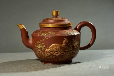 A YIXING MOULDED 'SQUIRRELS' TEAPOT