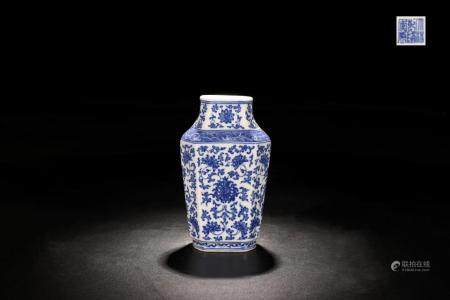 BLUE AND WHITE PORCELAIN VASE WITH FOLIAGE PATTERN