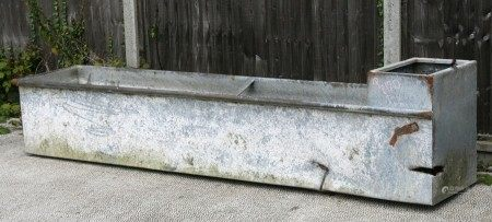 A large galvanised water trough or planter, 244cms (96ins) long.