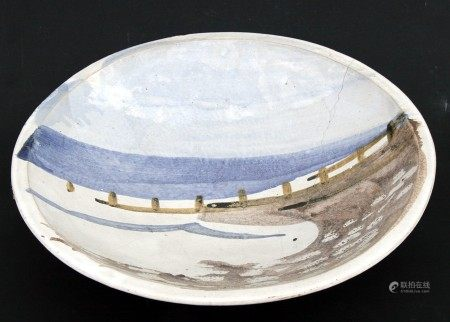 A Michael Woods Studio Pottery shallow bowl decorated with a beach scene, 41cms (16cms) (a/f).