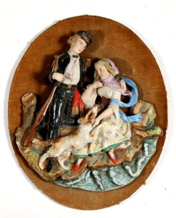 A Victorian figural bisque wall plaque depicting a young couple, 25cms (9.75ins) high.