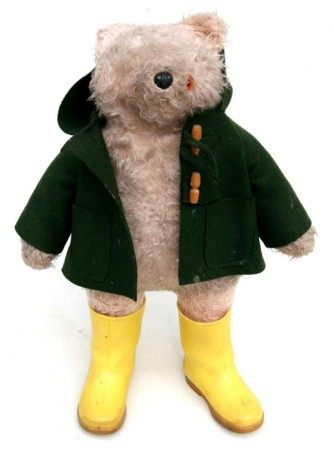 A Gabriel Designs Paddington Bear with green coat and yellow wellington boots, 53cms (21ins) high.