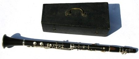 A four-piece rosewood clarinet in wooden carry case.