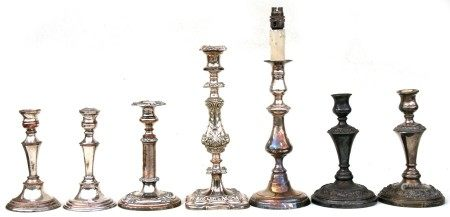 Two pairs of silver plated candlesticks; together with three single silver plated candlesticks.