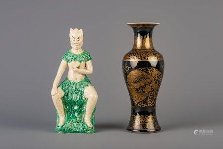 A Chinese monochrome black gilt decorated vase and a Shiwan figure, 19th C.