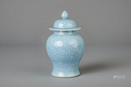 A Chinese monochrome blue vase and cover with incised floral design, 19th/20th C.