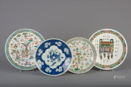 Three Chinese famille rose chargers and a blue and white charger, 19th C.