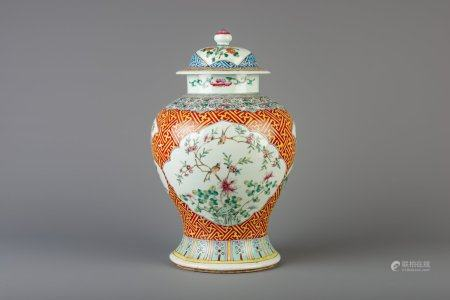 A Chinese famille rose vase and cover with floral design, 19th C.