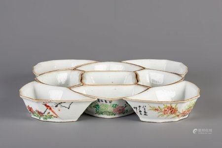 A Chinese famille rose sweetmeat or rice table set with birds among flowers, 19th C.