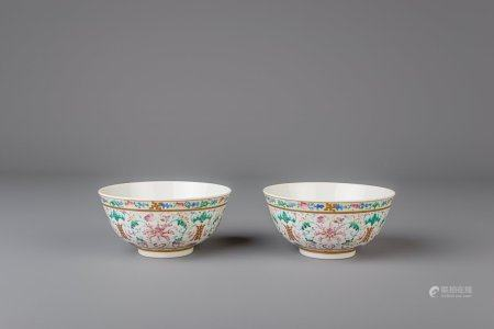 A pair of Chinese famille rose bowls with flowers and bats, Guangxu mark, 19th/20th C.