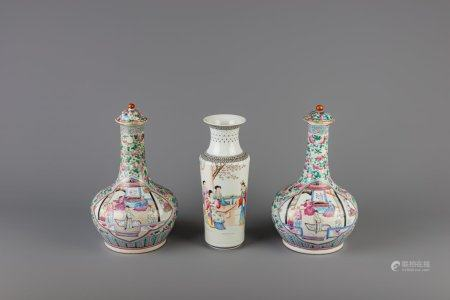 A pair of Chinese famille rose bottle vases and a rouleau vase, 19th C. and Republic