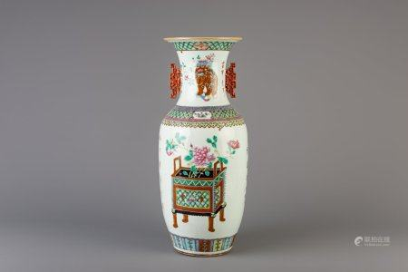 A Chinese famille rose vase with flowers and antiquities, 19th C.