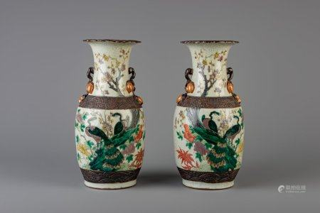 A pair of Chinese Nanking famille verte crackle glazed vases, 19th C.