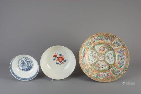 A Chinese Canton famille rose bowl, an Imari style bowl and a blue and white bowl, 18th/19th C.
