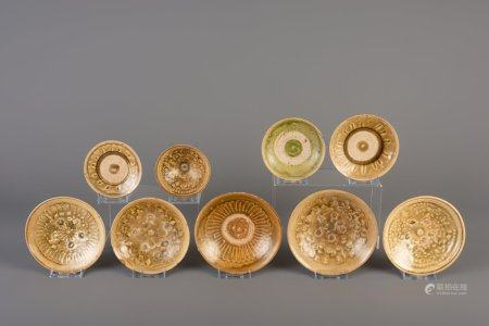 Nine Vietnamese green glazed saucers and bowls with underglaze design, Thanh Hoa, 9th/10th C.
