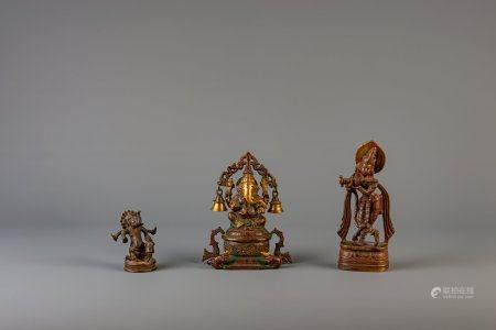 Three Indian bronze figures depicting Ganesha and Krishna, 19th/20th C.