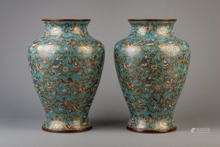 A pair of Chinese cloisonne vases with phoenixes and figures among flower vines, 19th/20th C.